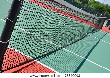 Tennis Court and Net on a Sunny Day - stock photo