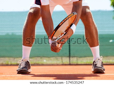 tennis court from low angle with Tennis player in action. - stock photo