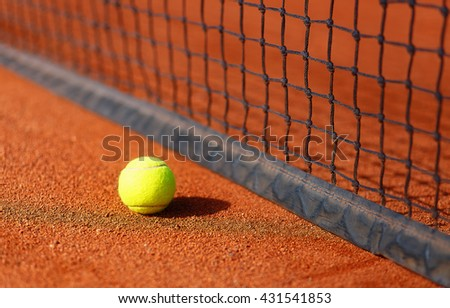 tennis court with tennis ball and antuka background. - stock photo