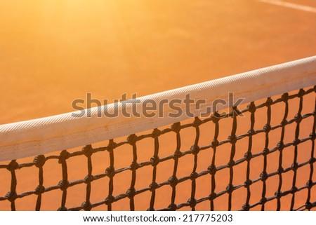 Tennis net with sun flare. - stock photo