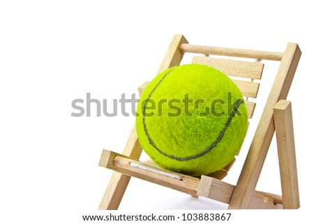 Tennis on the chair - stock photo