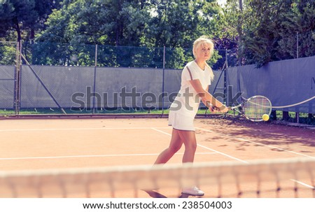 tennis player hit the ball. concept about sport and competition - stock photo