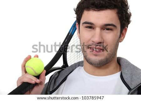 Tennis player on white background - stock photo