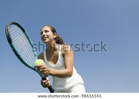 Tennis Player Preparing to Serve - stock photo