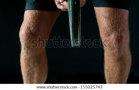 tennis player's legs - studio study of man's legs in tennis poses - stock photo