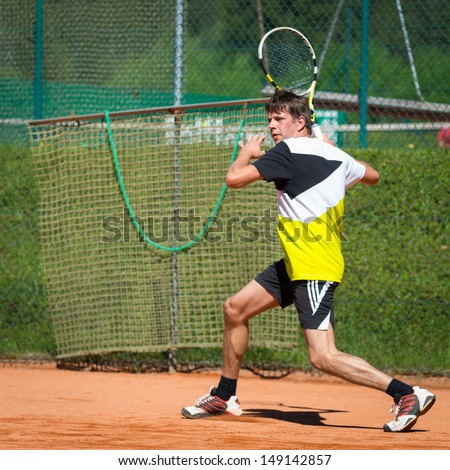 tennis player waiting for ball on sand court - stock photo
