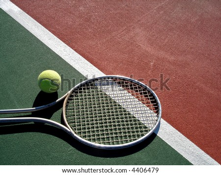Tennis racket and ball on court - stock photo