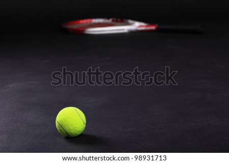 tennis racket and balls on black background studio shot - stock photo