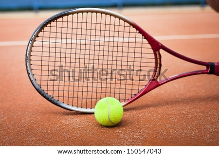 tennis racket and tennis ball - stock photo