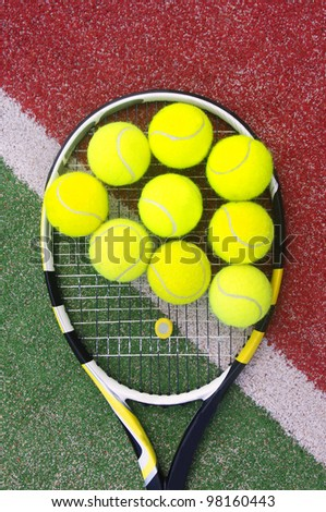 tennis racket with balls on court - stock photo