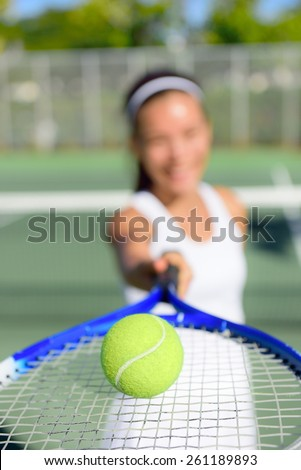 Tennis. Woman tennis player showing ball and racket on tennis court outside. Female tennis player. - stock photo
