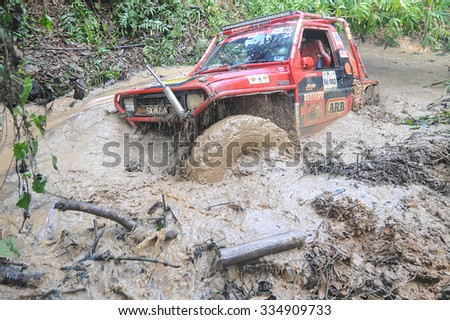 Tenom Sabah Malaysia - Oct 29, 2015:4x4 enthusiast wading a muddy trail using modified four wheel car in the jungle of Sabah Borneo.Jungle of Borneo is famous for 4x4 adventure tourism. - stock photo