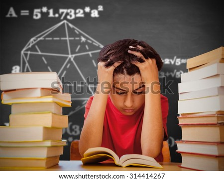 Tensed boy sitting with stack of books against black background - stock photo