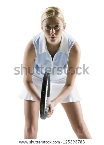 Tensed female tennis player with racket - stock photo