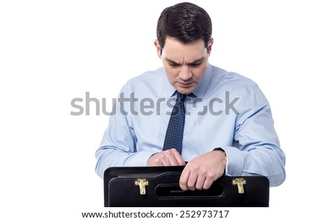 Tensioned businessman searching documents in his bag - stock photo