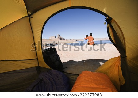 Tent and Campers in Desert - stock photo