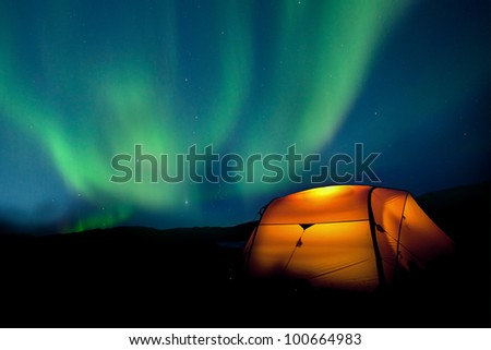 Tent and Northern lights - stock photo