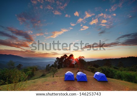 Tent camping in nature with wide angle landscape - stock photo