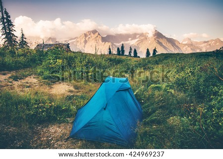 Tent camping with Rocky Mountains Landscape Travel Lifestyle concept Summer adventure vacations outdoor - stock photo