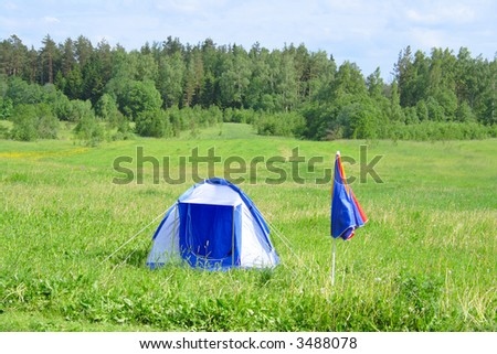 tent in the field - stock photo
