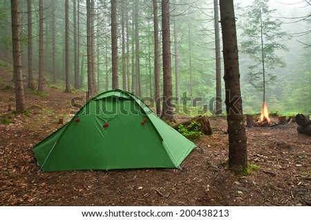 tent in the mist forest - stock photo