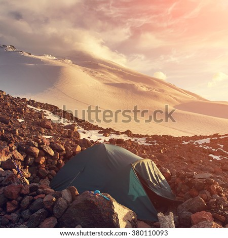 tent in the mountains. alpine camp. climbing and hiking - stock photo
