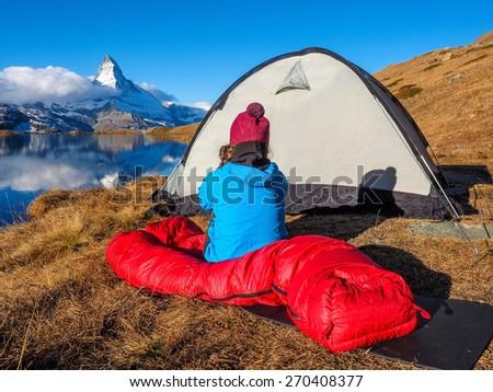 Tent near Matterhorn during early morning with relfection in StelliSee, Zermatt, Switzerland - stock photo