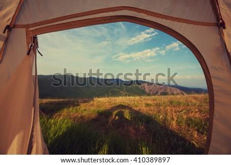 tent on green grassland - stock photo
