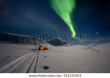Tent under northern Lights in Lapland - Sweden - stock photo