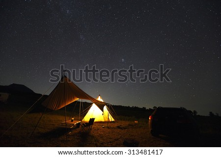 Tent with starry sky - stock photo