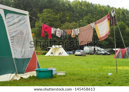 Tents and a clothing line on a Campsite in the Belgian Ardennes - stock photo