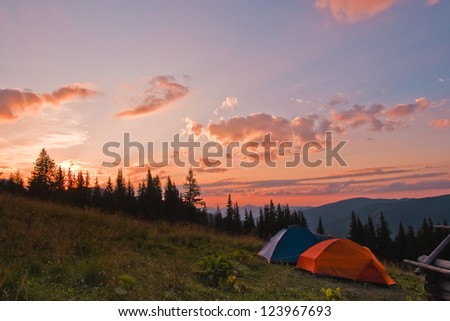Tents at sunset - stock photo