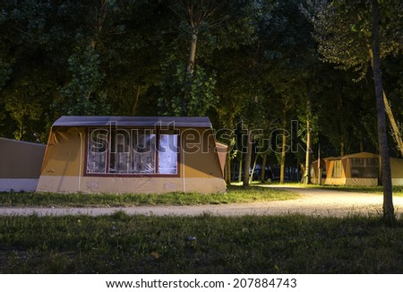 Tents in camping in the night - stock photo
