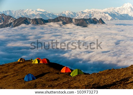 tents settled on a mountain - stock photo