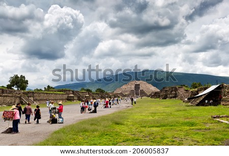 TEOTIHUACAN, MEXICO - JUNE 25: Pyramid of the Moon on JUNE 25, 2014 in Teotihuacan, Mexico. Teotihuacan is an enormous archaeological site in the Basin of Mexico, northeast of Mexico City. - stock photo