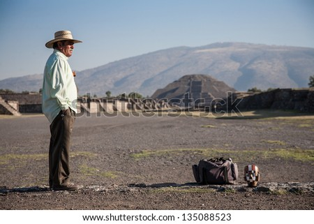 TEOTIHUACAN, MEXICO -MARCH, 3, 2012: Unknown man selling souvenirs in Teotihuacan, on the Avenue of the Dead leading to the Pyramid of the Moon  on march 3, 2012 in Teotihuacan, Mexico, 2012 - stock photo