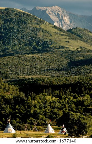 Tepees in Alpine Meadow - stock photo