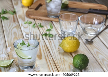 Tequila, GIN,  vodka in a glass with ice, lime, a cocktail bar, alcohol, alcoholic beverage. Closeup - stock photo