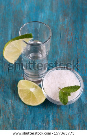 Tequila in glass on wooden table close-up - stock photo