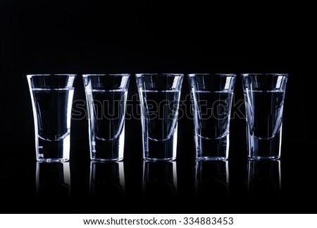 Tequila in shot glasses - stock photo