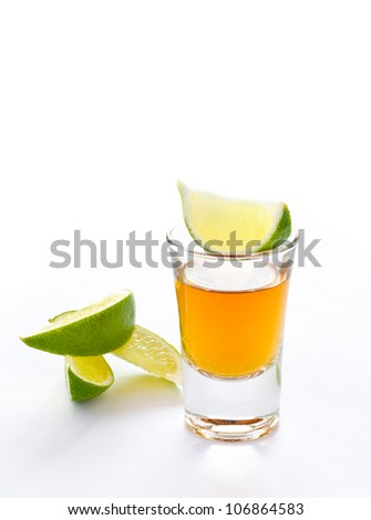 Tequila shot with lime and white background - stock photo