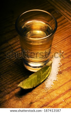 Tequila shot with lime slice and salt - stock photo