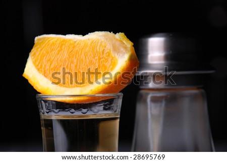 tequila shot, with orange - stock photo