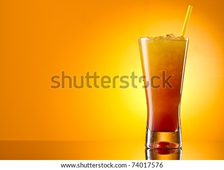 Tequila sunrise Cocktail isolated on a orange background - stock photo