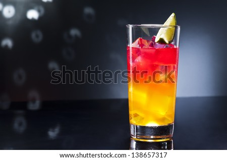 Tequila sunrise, the story about the drink says that it was first served in Cancun and Acapulco in the 1950's. After a brief surge in 70's discos, it lost much of its glory. - stock photo