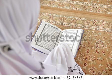 Terengganu , Malaysia - 20 Jun 2016 : Muslim yong girl  Reading Holy Islamic Book Koran in beautiful mosque in Terengganu Malaysia  - stock photo