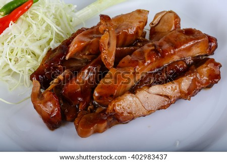 Teriyaki chicken with herbs and spices served cabbage - stock photo