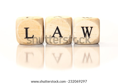 Term Law spelled from toy cubes, dice letters with reflection on bottom. Studio shot on White background. - stock photo