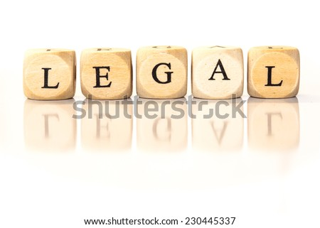 Term Legal spelled from toy cubes, dice letters with reflection on bottom. Studio shot on White background. - stock photo