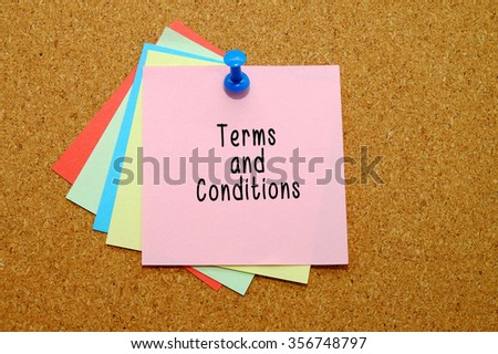 terms and conditions written on color sticker notes over cork board background. - stock photo